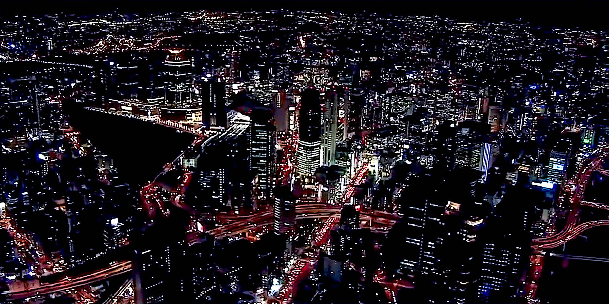 ヘリコプターで大阪上空から見る梅田駅周辺の夜景