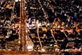 ヘリコプターで大阪上空から見る難波駅周辺の夜景